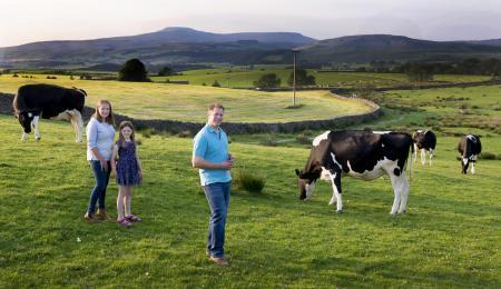 The Robinson family with some of the dairy herd which provides milk for the ice cream